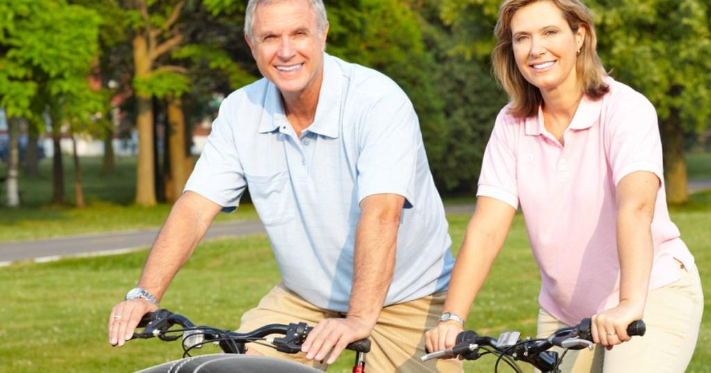 Man and woman riding bikes together Bikeroo