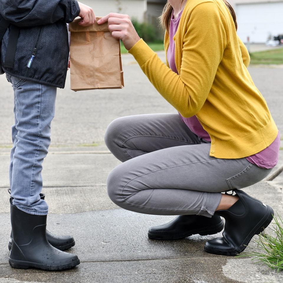 boy wearing black Totes Cirrus Charley Kids Rain Boots
