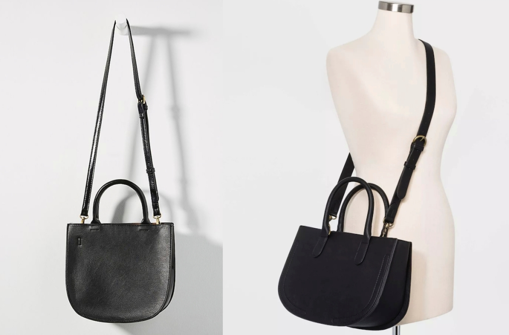 two black satchel purses hanging up