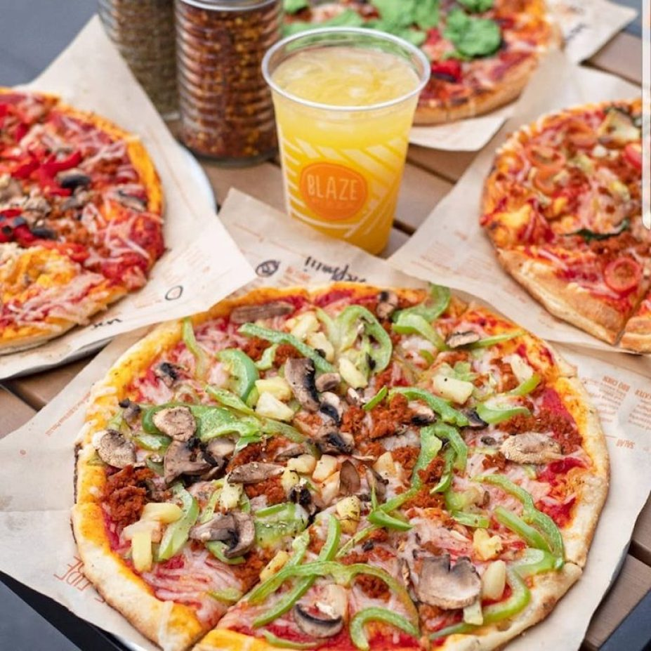 blaze pizza with an orange drink
