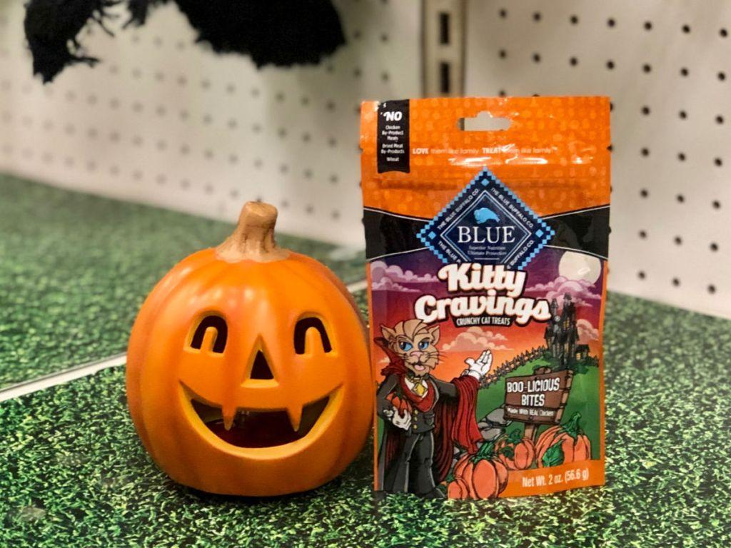 Blue Buffalo Kitty Cravings Crunchy Cat Treats next to pumpkin
