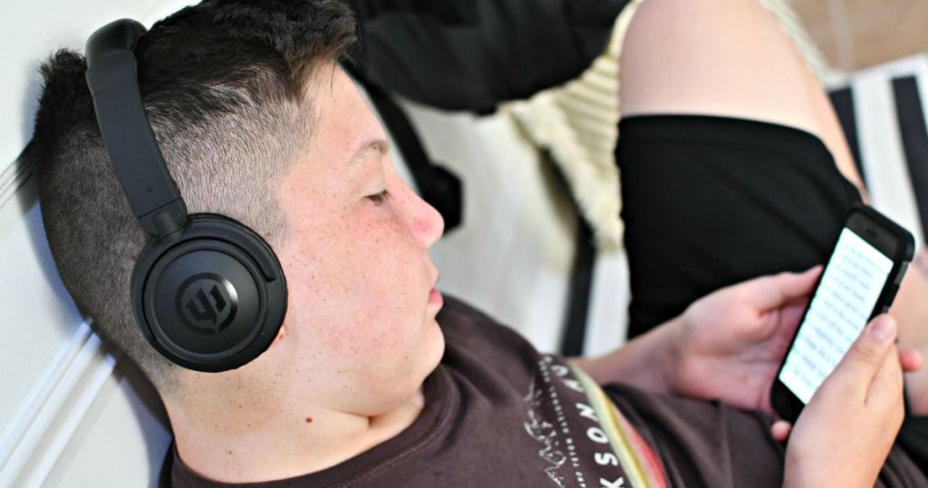 boy listening to an audiobook with headphones