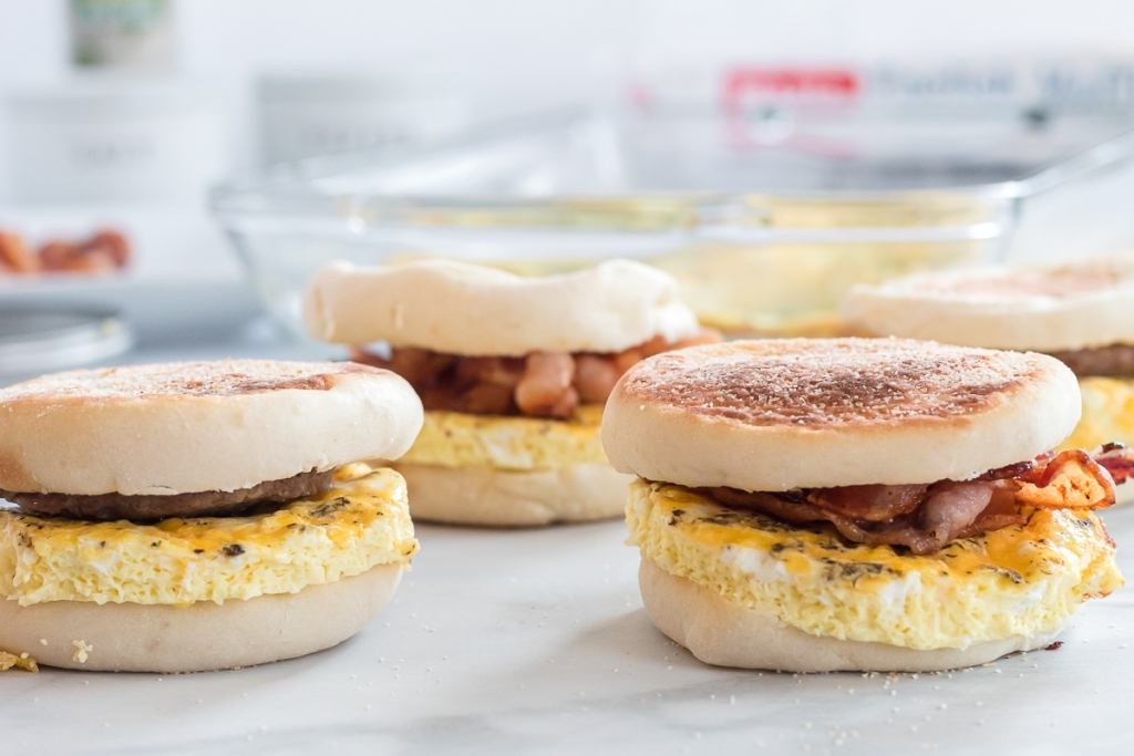 Breakfast sandwiches with bacon on counter