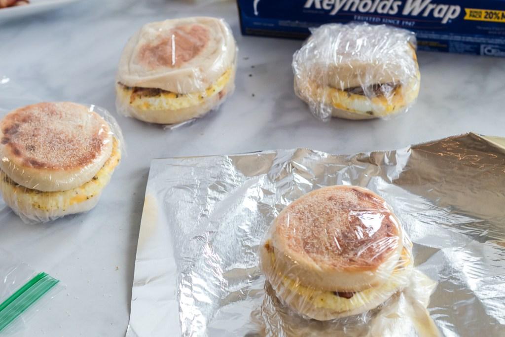 breakfast sandwich wrapped in plastic wrap and foil