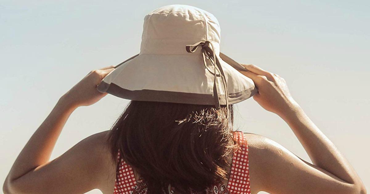 Woman wearing a beige sun hat