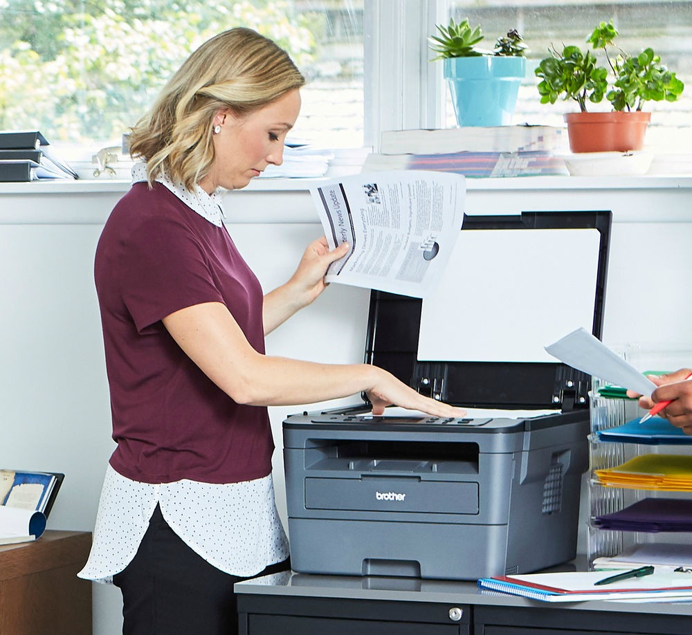 Brother Monochrome all-in-one printer on file cabinet