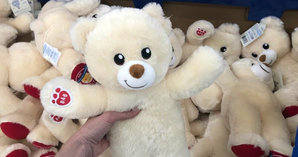 hand holding Build-A-Bear Bear