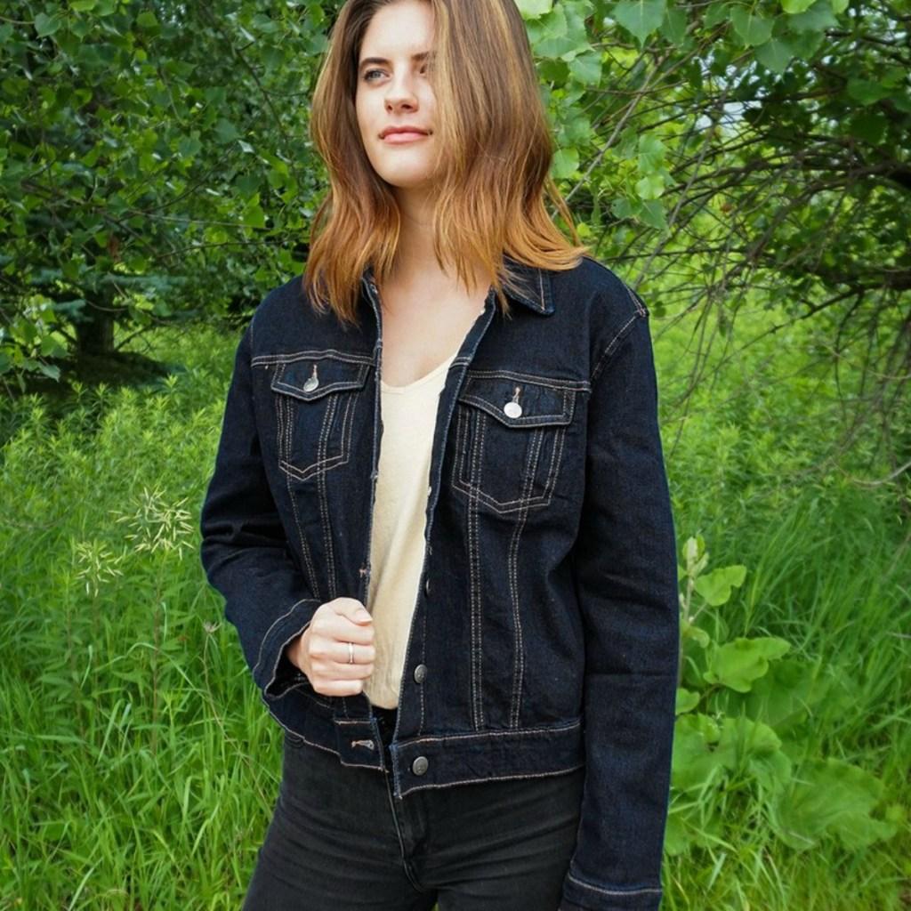 Woman wearing a dark denim jacket