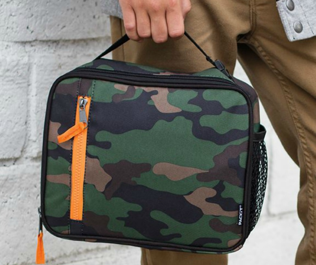 Classic Camo print lunch box in hand at school
