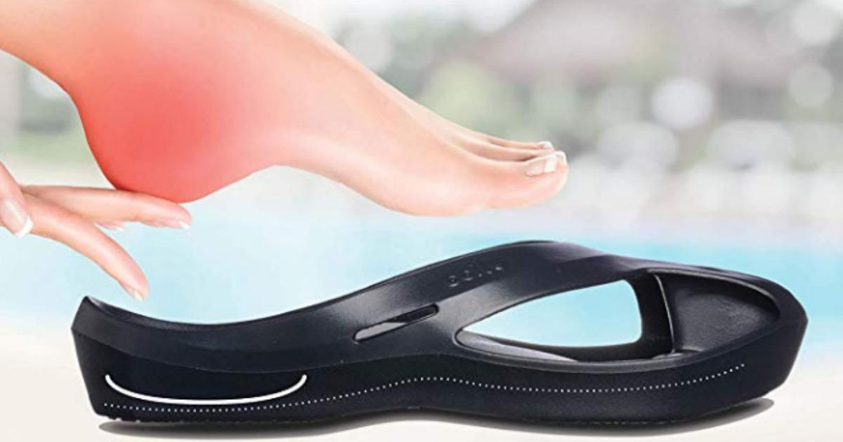 woman's foot near a Ccilu massaging andal