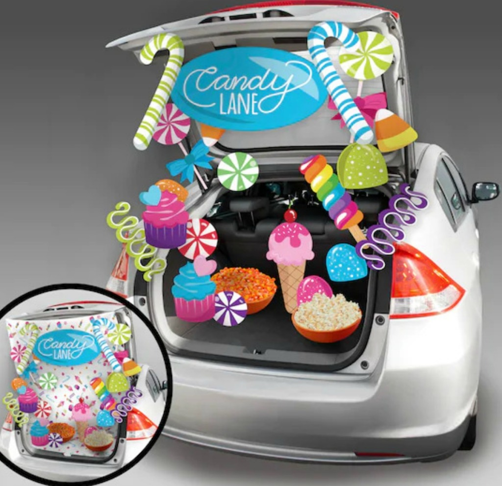 Candy themed Trunk or Treat decor kit set up in silver sedan trunk