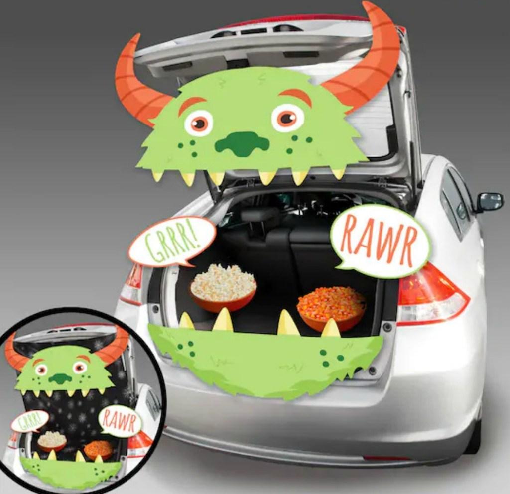 Monster themed Trunk or Treat decor kit set up in silver sedan trunk