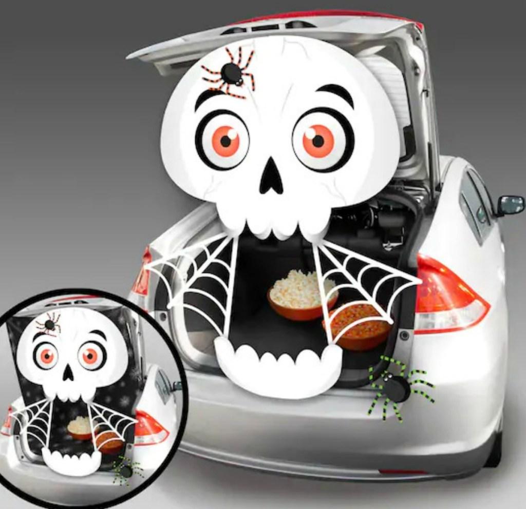 Skeleton themed Trunk or Treat decor kit set up in silver sedan trunk