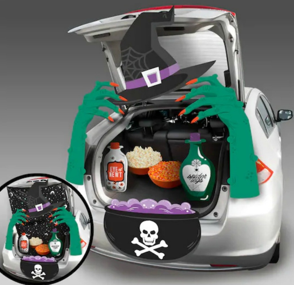 Witch themed Trunk or Treat decor kit set up in silver sedan trunk