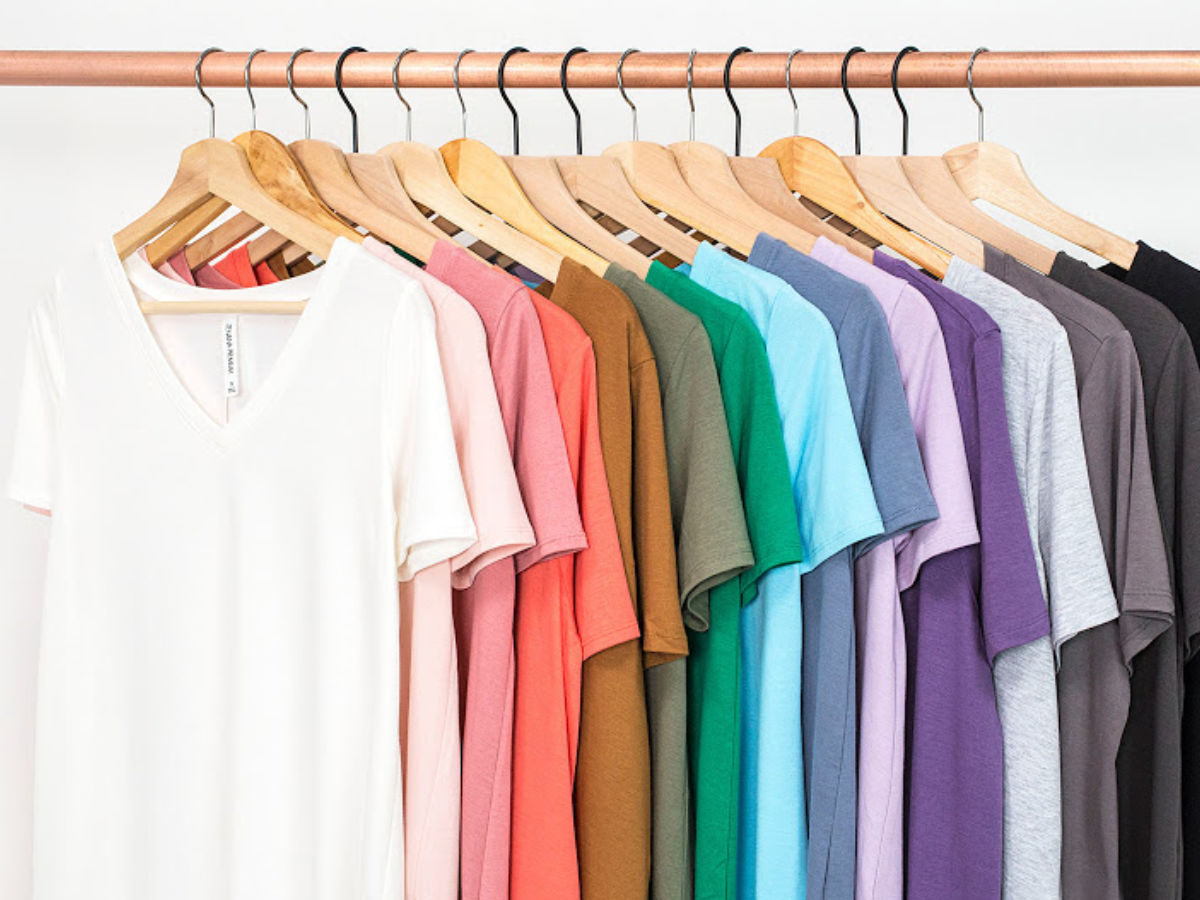 Cents of Style Boyfriend T-Shirt on clothing rack with wooden hangers