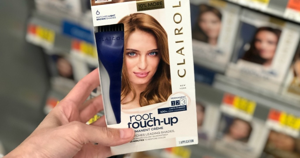Clairol Root Touch-Up being held by a woman's hand