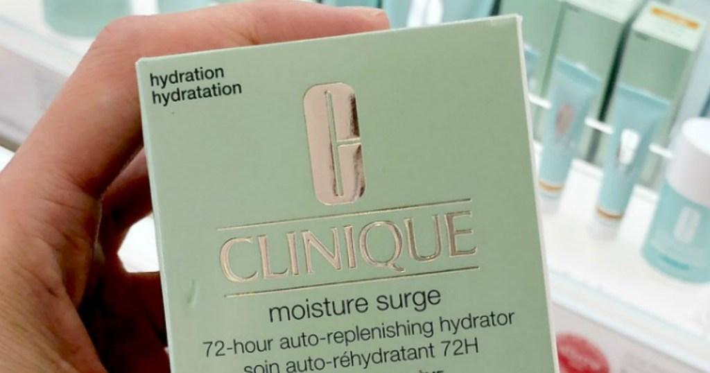 hand holding Clinique Moisture Surge