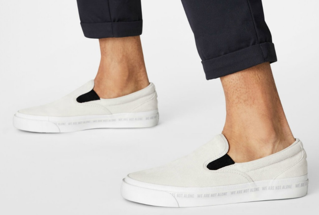 Man wearing Converse Slip On Shoes Unisex in cream color