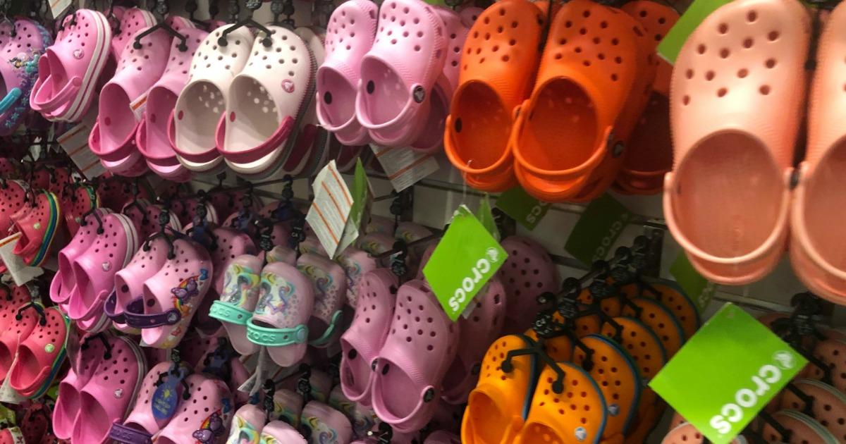 Crocs Kids Shoes hanging on wall