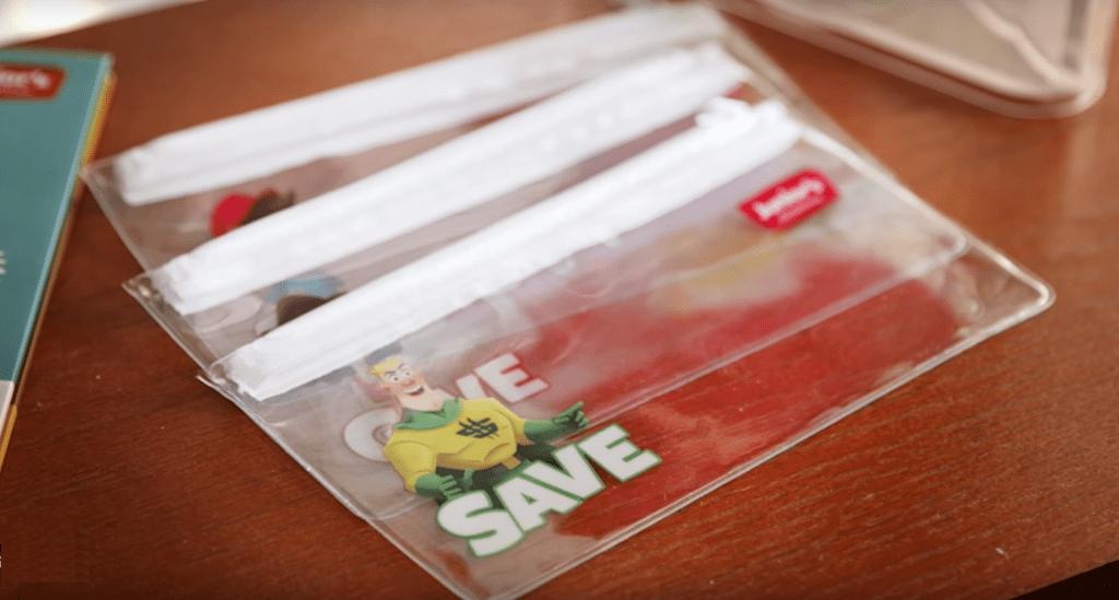 Dave Ramsey's Financial Peace Junior Kit for Kids envelops on desk