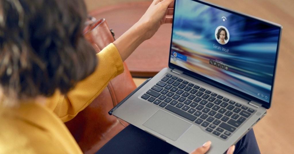 Dell 2-in-1 laptop in lap of woman