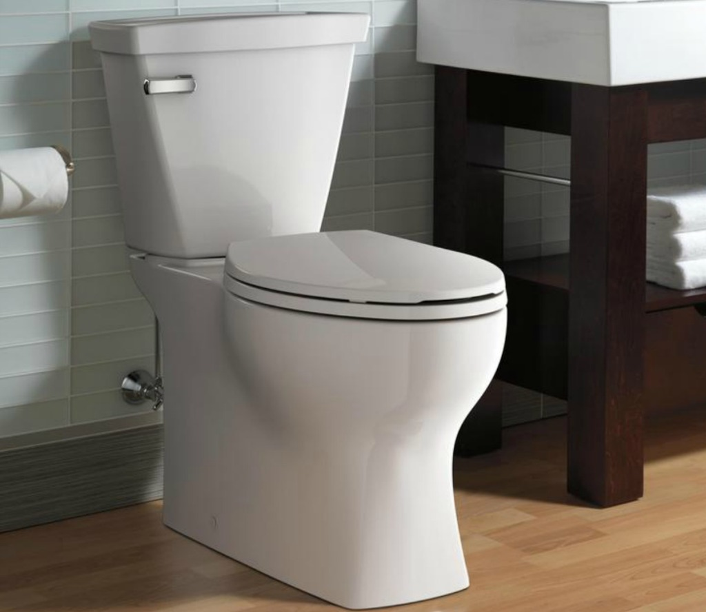 A white porcelain toilet in bathroom setting