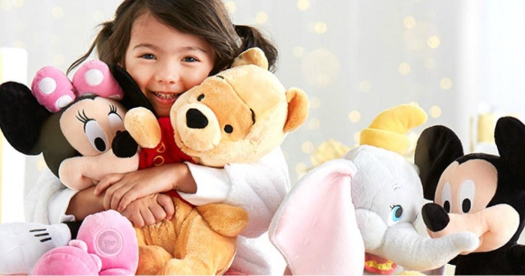 girl holding disney dolls