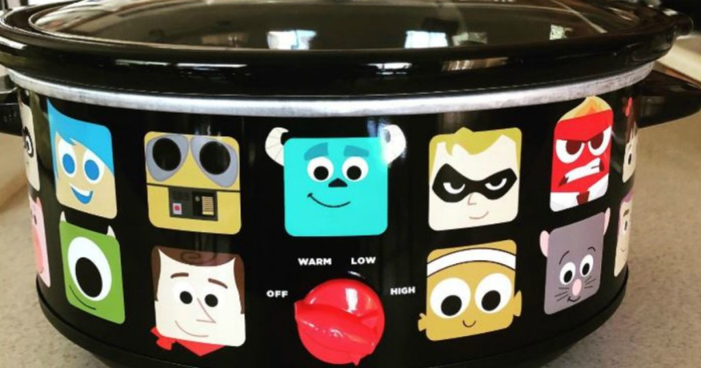disney characters on black crockpot on counter