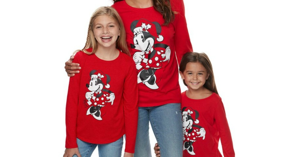 woman and girls wearing matching Disney holiday tees