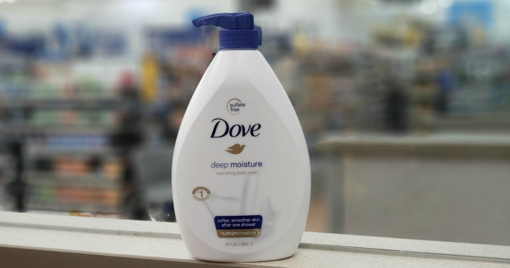 Dove brand body wash in large bottle with pump on ledge in store