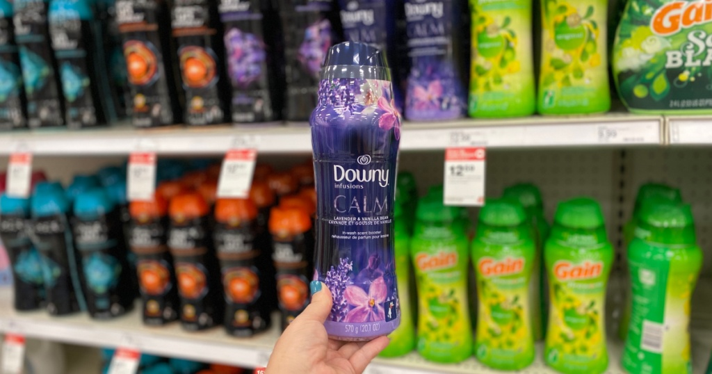 hand holding up bottle of downy infusions at target