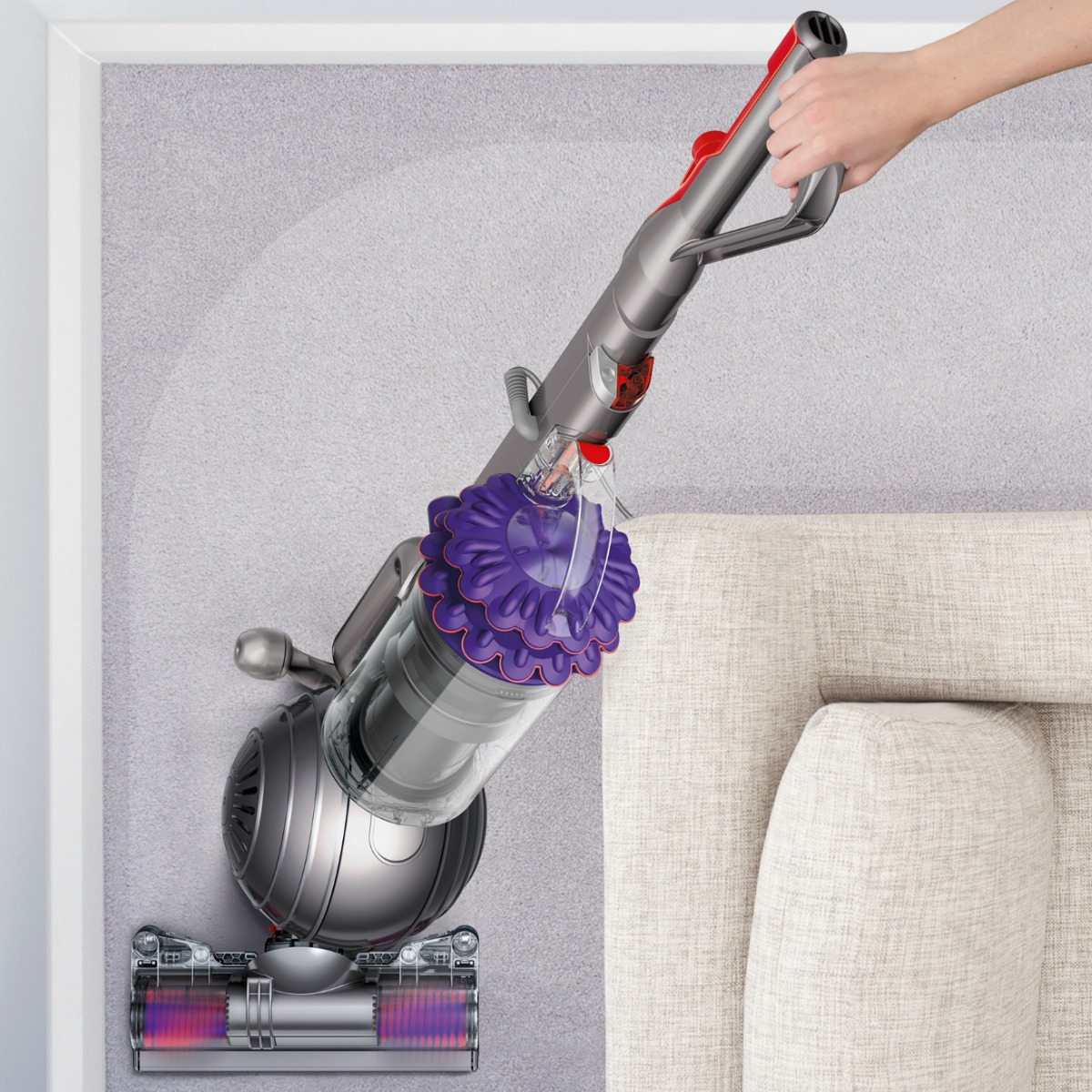 Dyson Pet Vacuum in use near couch