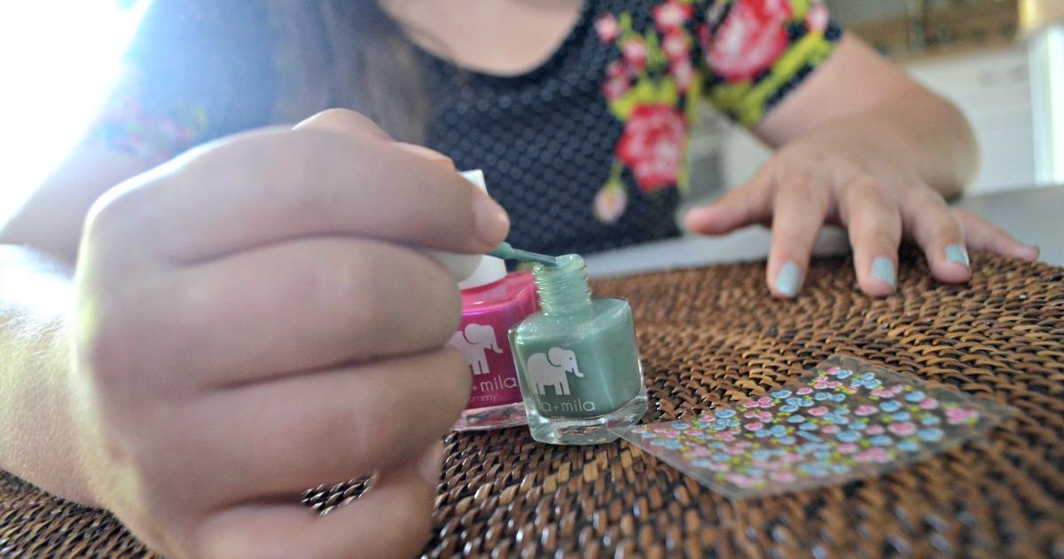 Girl painting nails with Ella+Mila Nail Polish