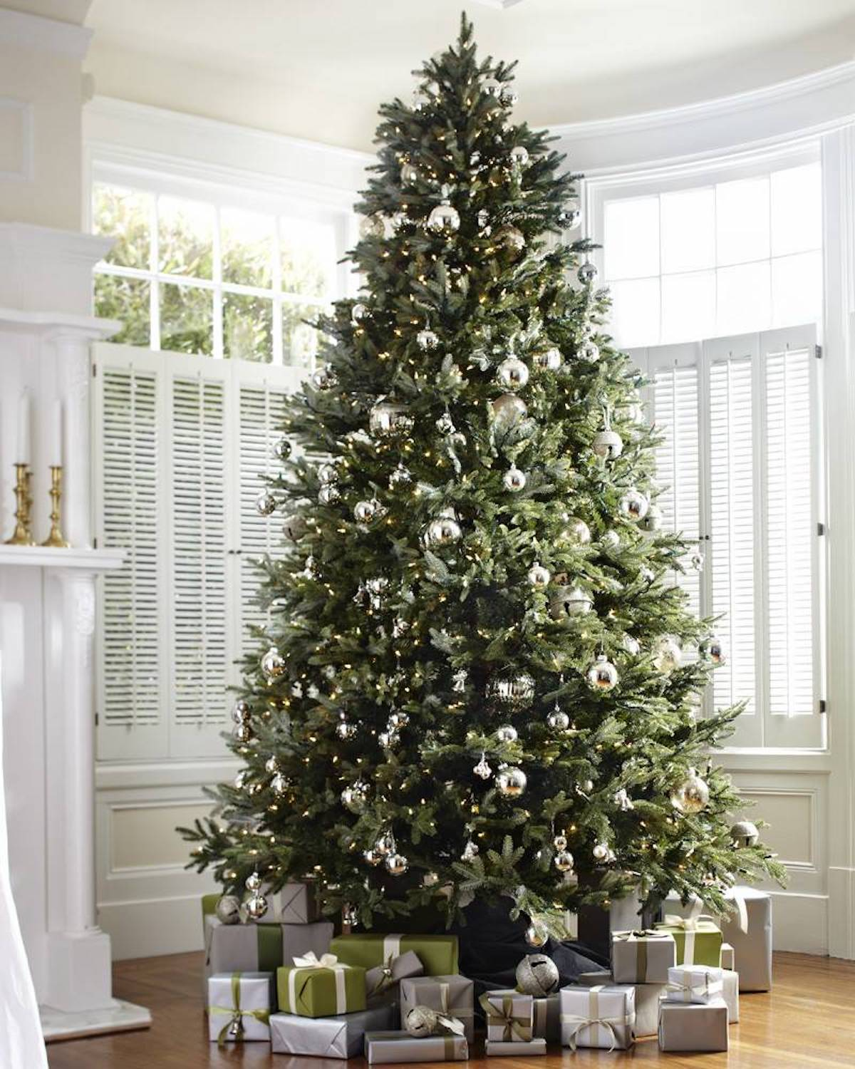 artificial christmas tree with ornaments and wrapped presents