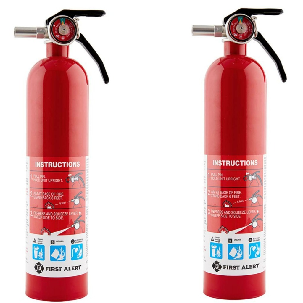 Two red metal fire extinguishers