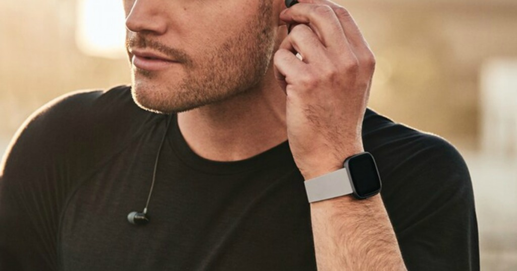 man wearing Fitbit Versa Smartwatch