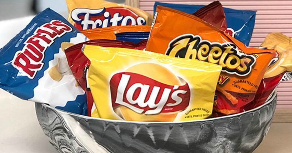 silver bowl full of frito lay snack bags