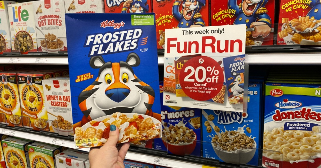 hand holding up box of frosted flakes cereal at target
