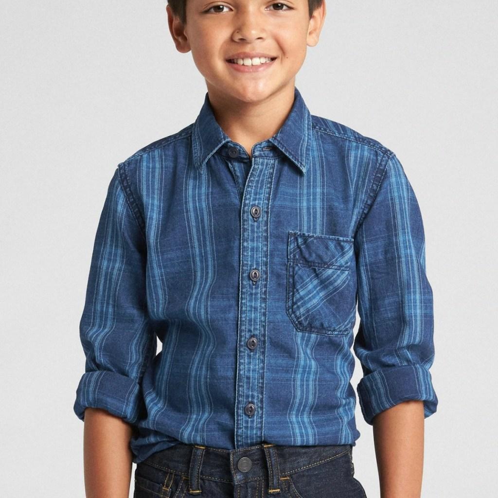 Kid wearing long sleeve plaid shirt