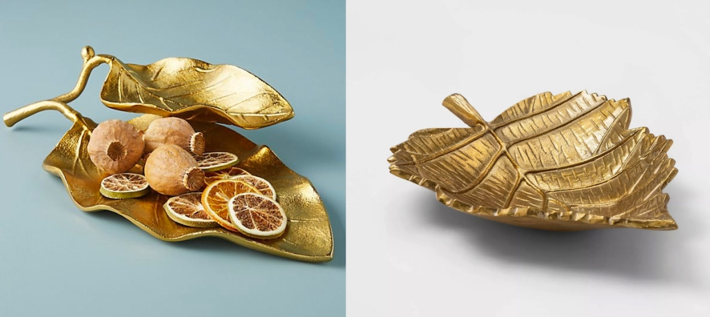 two gold leaf serving trays with dried oranges