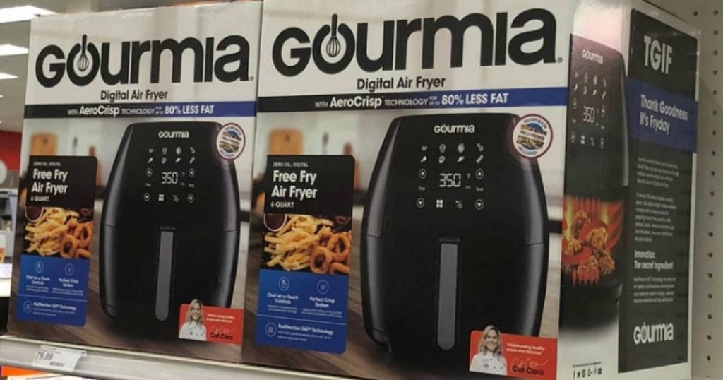 Store display of Gourmia digital air fryers in package