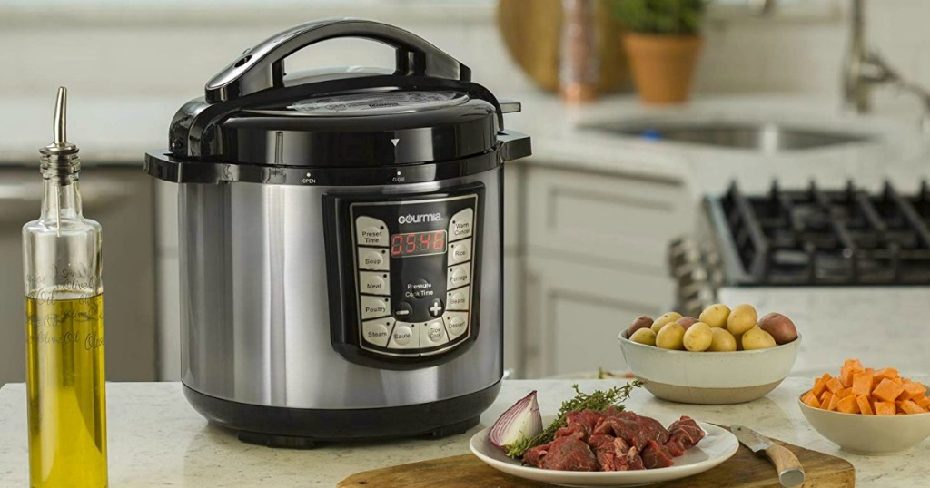 Gourmia Pressure cooker on the kitchen counter top with food