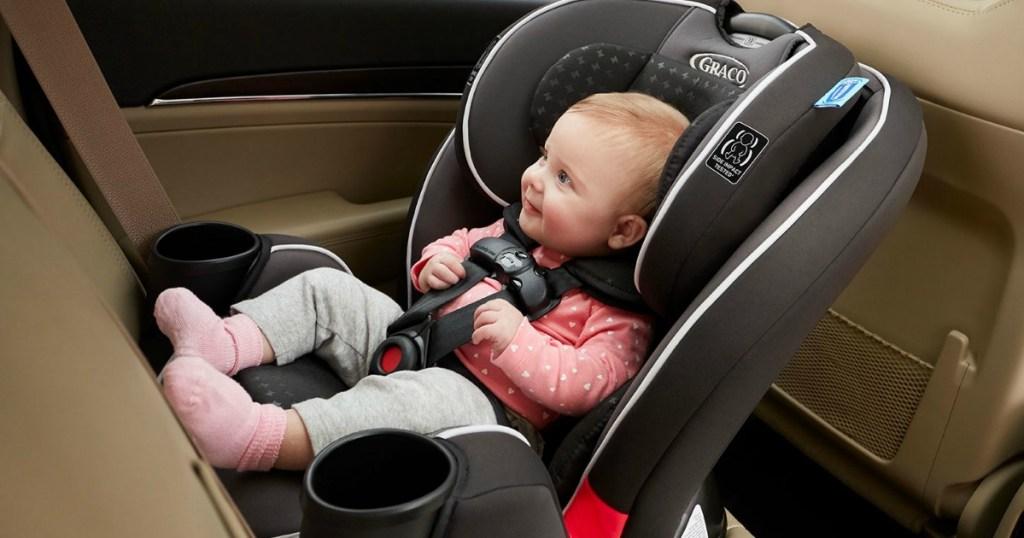 Baby in Graco Car Seat in car