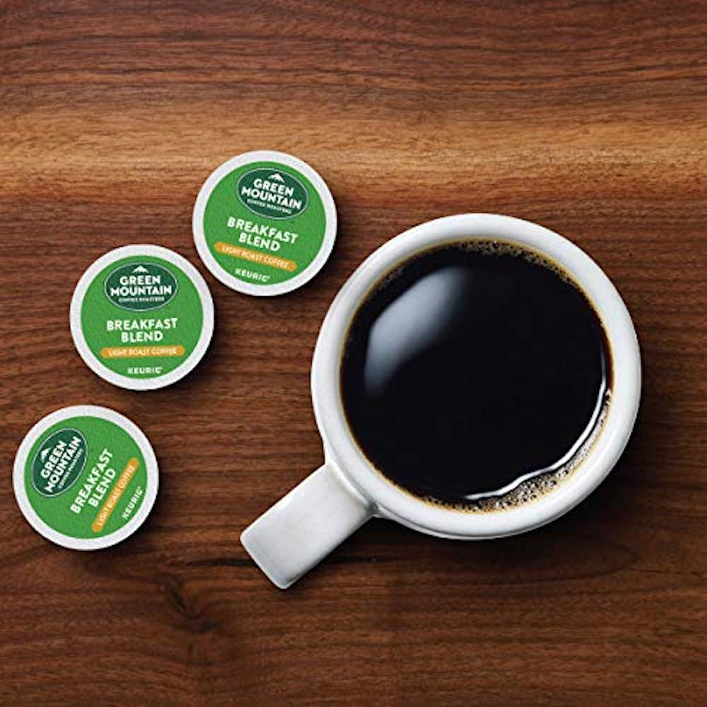 K-Cups next to coffee cup