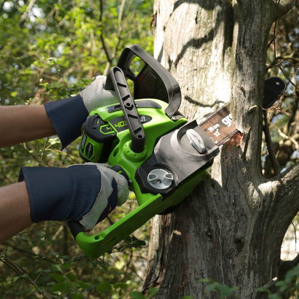 Greenworks Cordless Chainsaw cutting trees