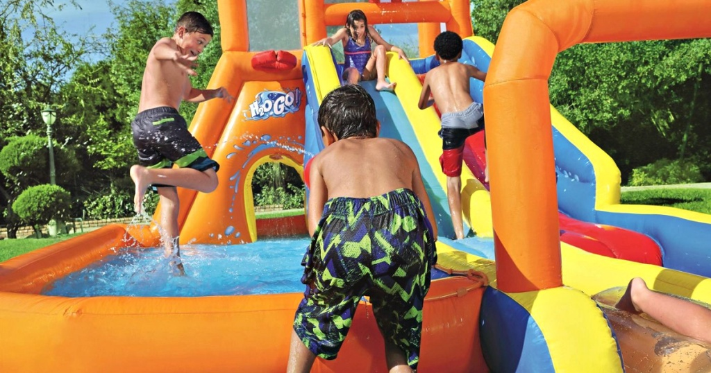 kids playing on inflatable water slide park
