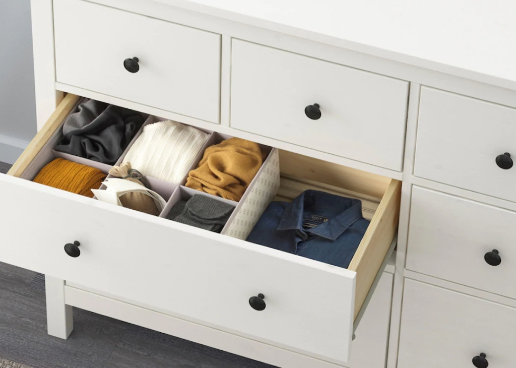 white dresser with clothes