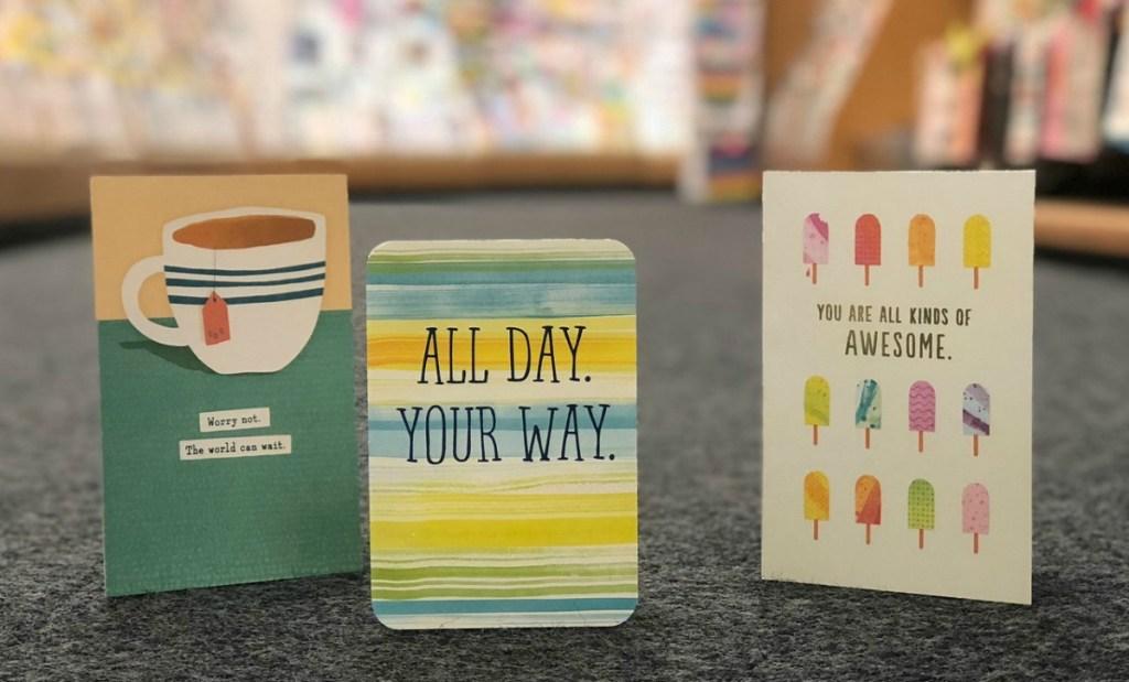 Three Hallmark Greeting Cards in Hallmark Store location