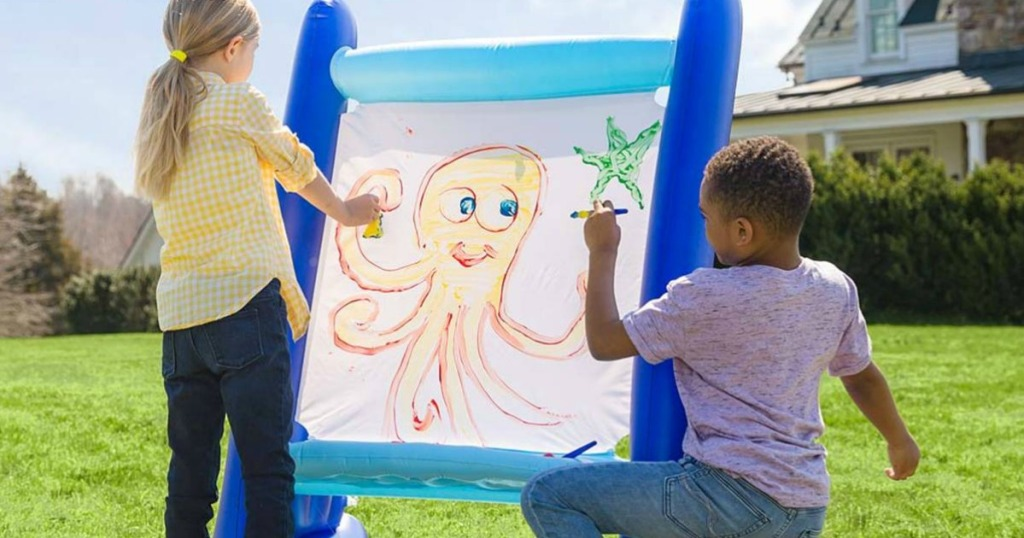 Kids painting on a HearthSong Giant Inflatable Easel