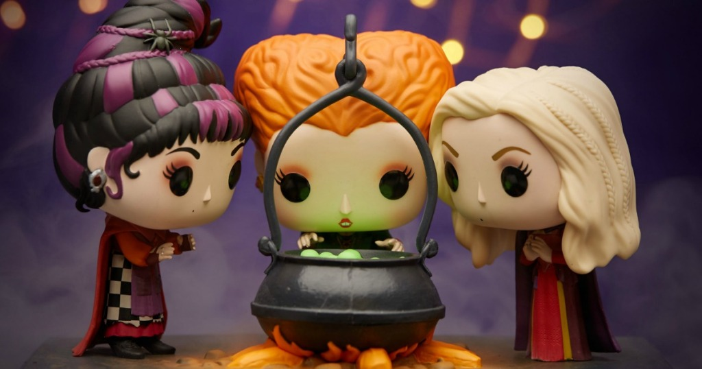 Hocus Pocus Funko Pop! figures placed around a toy cauldron